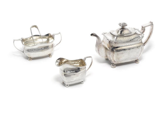 A George III Irish silver matched three piece tea service and pair of sugar tongs, teapot, maker's mark mistruck, Dublin 1814, cream jug and sugar bowl, maker's mark rubbed, Dublin 1809, sugar tongs, Hibernia and town mark only,  (4)