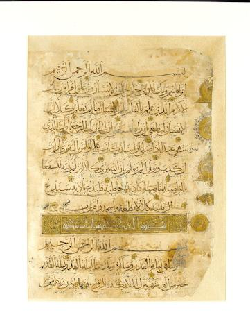 A large Ilkhanid Qur'an leaf with four sura headings Persia, 14th Century