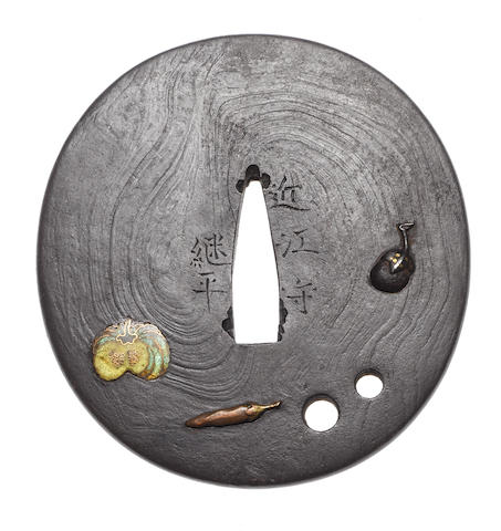 An iron tsuba By Fujita Tsuguhira, late 18th/early 19th century
