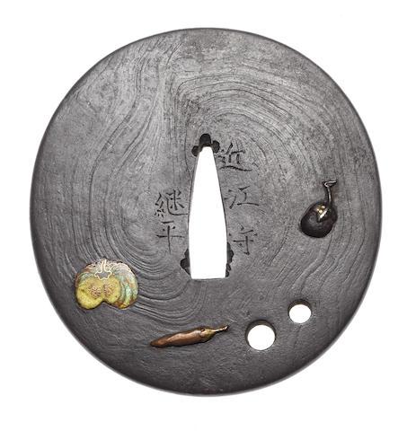 An iron tsuba By Fujita Tsuguhira, late 18th/early 19th century