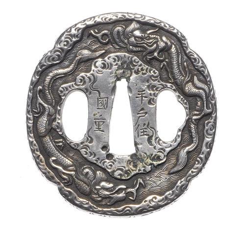 A silver tsuba By Kunishige, Hizen School, late 18th/early 19th century