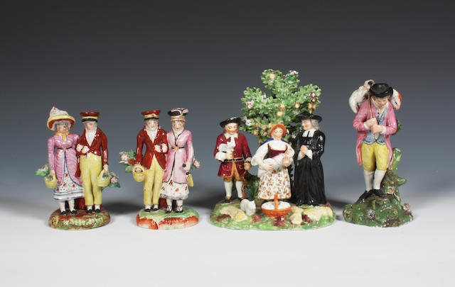 A Staffordshire pearlware figure, a matched pair of figure groups and a Tithe pig figure group