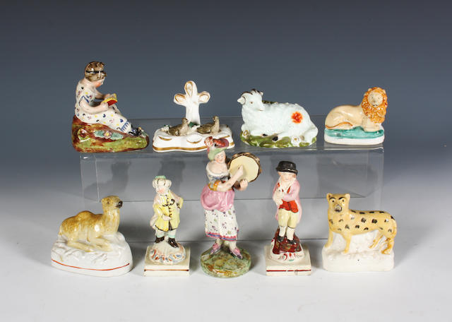 A group of English pottery and porcelain figures and animals 19th Century.