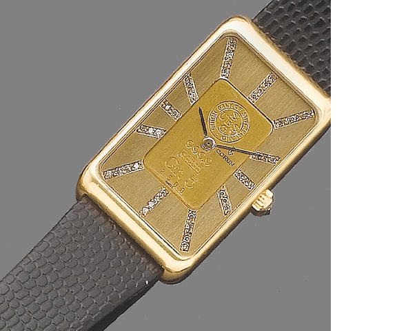 A gentleman's diamond-set wristwatch, by Corum