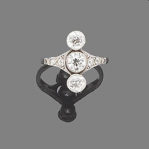 An early 20th century diamond three-stone ring,