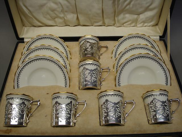 A set of 6 silver mounted coffee cups & saucers the silver by Docker & Burn Ltd., Birmingham 1922, the porcelain by Aynsley