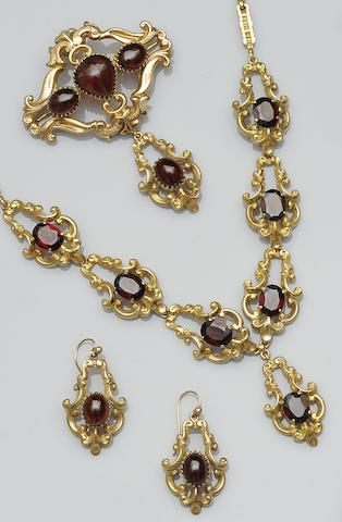 A garnet necklace brooch and earpendants