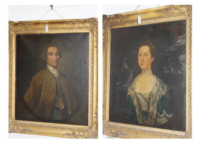 British School, late 18th Century Portrait of a gentleman, half length, and another of a lady, within painted ovals, a pair, 72cm x 62cm