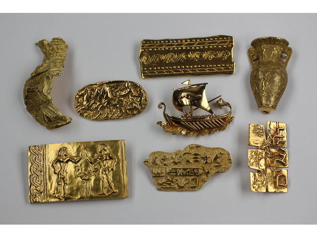 A collection of eight yellow precious metal brooches of Greek designs