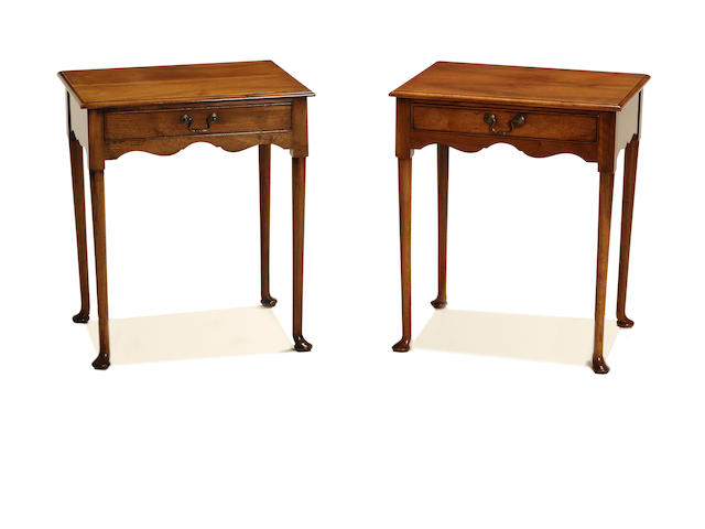 A pair of George II style walnut side tables by Arthur Brett