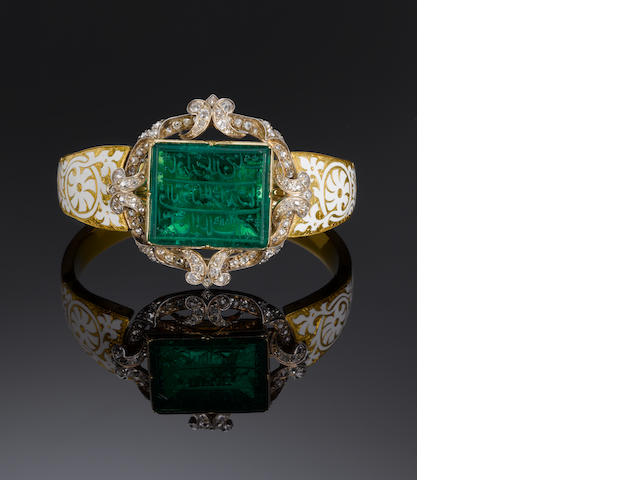 An important Mughal inscribed Emerald mounted in an early Victorian diamond-set enamelled gold Bangle