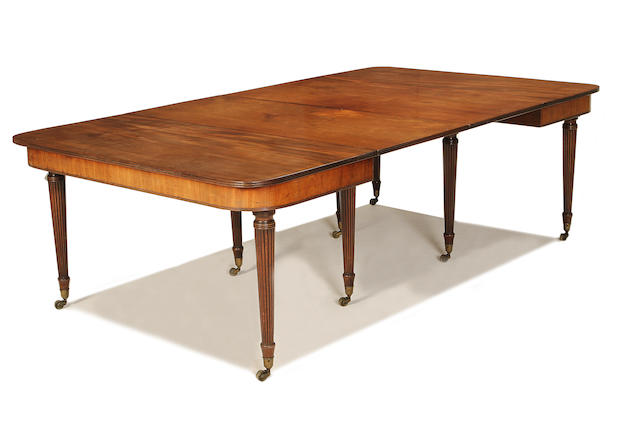 An early Regency mahogany telescopic-action extending dining table