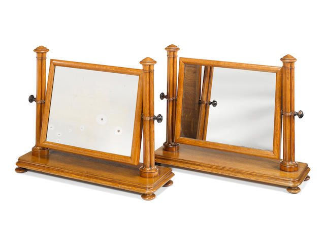 A pair of George IV oak swing-frame toilet mirrors