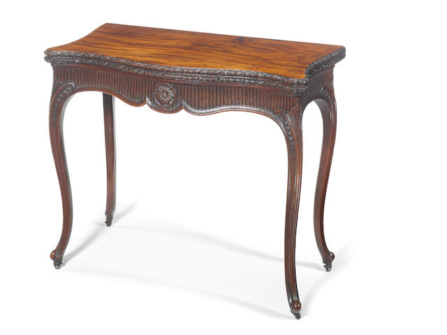An important George III carved mahogany serpentine concertina-action tea table attributed to Mayhew and Ince?, in the French Hepplewhite taste