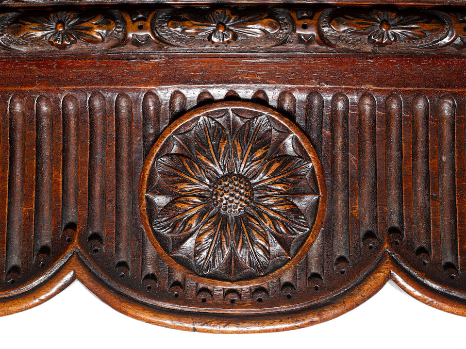 An important George III carved mahogany serpentine concertina-action tea table in the French Hepplewhite taste