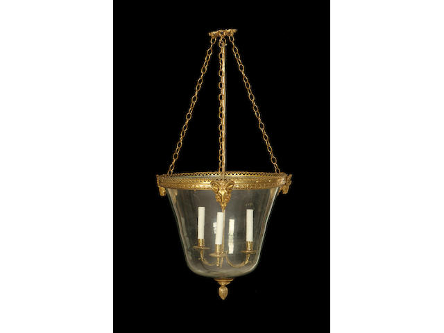 A set of three large Regency style gilt metal and glass hanging lanterns