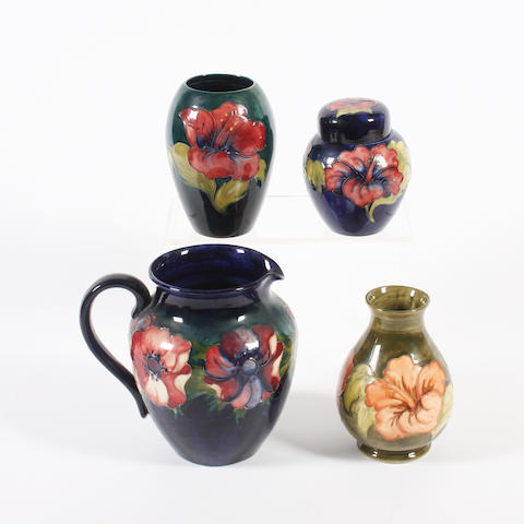 A Moorcroft 'Anenome' jug, two 'Hibiscus' vases and a small 'Hibiscus' jar and cover