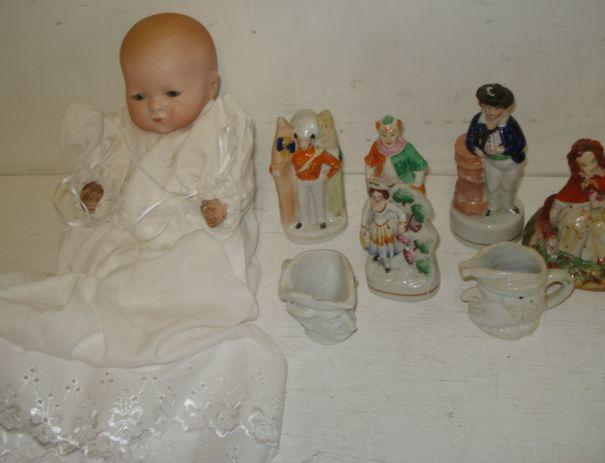 Five small Staffordshire figures, 'Red Riding Hood', 'Jack Tar', 'Clown', 'Grape Harvester', 'Soldier', a Mr Punch miniature jug, another 18th Century Officer and an Armand Marseille bisque headed dream baby doll, the head impressed '341/2k'.