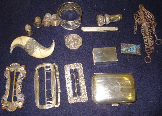 Two 19th Century white metal buckles, pierced steel chatelaine clip and enamelled brass buckle, a silver mounted double tiger claw brooch, a silver seal or cane handle, seven various thimbles, an 1893 Army Temperance Association medal, a shoe shaped pen knife, another with mother of pearl handle and a small enamel filigree panel, a silver metal case, cigarette case and Chinese napkin ring.