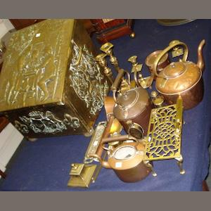 A collection of brass and copper wares to include:- a slope top slipper box with embossed decoration, two copper kettles, a copper saucepan and lid, a conical measure, three brass pepperettes, two pairs of candlesticks, a porcelain mounted brass inkwell, trivet, ladle, pen tray and paper knife.