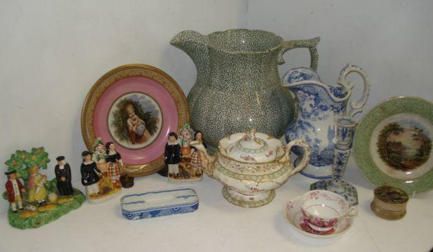 A Staffordshire Tithe-Pig group, 17cm, pair of Staffordshire highland figure group flatback mantel ornaments, R & C 'The Seranade' blue transfer printed toilet jug and basin, early 19th Century pearlware pen tray, prattware The Village Wakes pot lid and base, Pratt ware plate and dish, orignally part of a comport, Sunderland lustre Temperance tea cup and saucer, c.1830, early Victorian teapot, and a large early Victorian green transfer printed lobed baluster toilet jug.