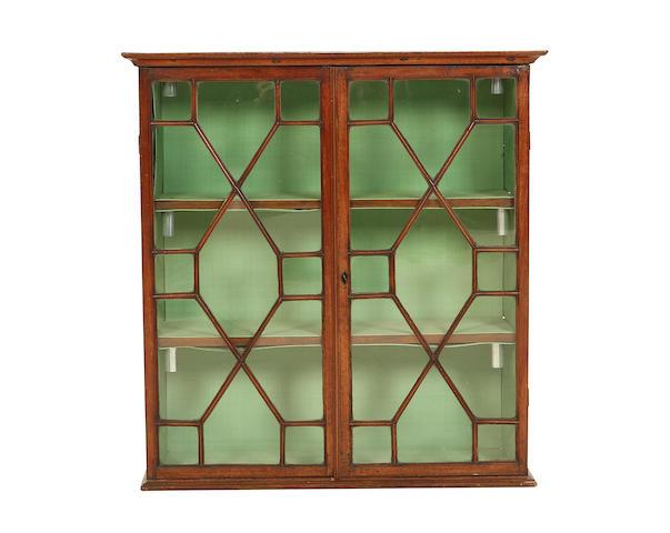 A George III mahogany hanging display cabinet