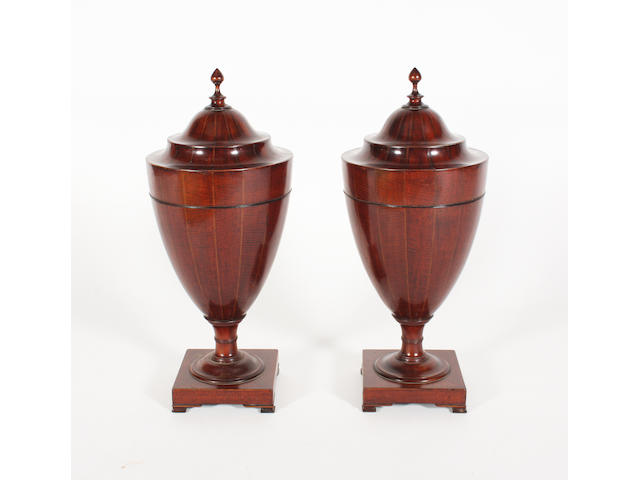 A pair of 19th century figured mahogany, chevron and chequer line inlaid cutlery urns of good colour