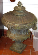 "#A pair of French cast iron terrace urns and covers, each of scroll handle campana form moulded with bands of laurel on slender square pedestal bases, 66cm high, 25.5"" high) 51cm diameter."