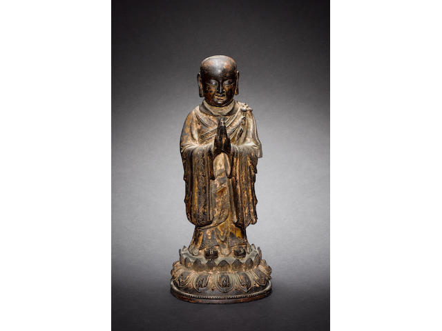 A gilded bronze figure of a standing Luohan or other Buddhist Disciple Ming/Qing Dynasty