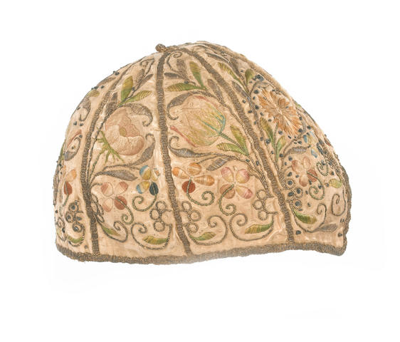A child's embroidery cap English, mid 17th Century