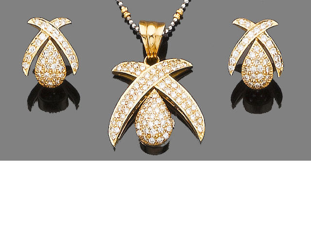 A diamond pendant necklace and a earring suite (2)