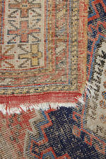 An Afgan carpet, with three rows of quartered guls on a rust ground, 3.3m x 2.5m, and a North West Persian rug, worn.(2)