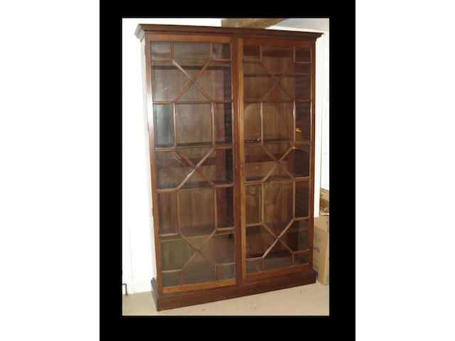 A mahogany glass fronted bookcase,