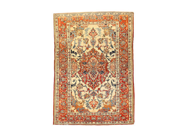 A pair of Isfahan rugs Central Persia, 193cm x 138cm (2)