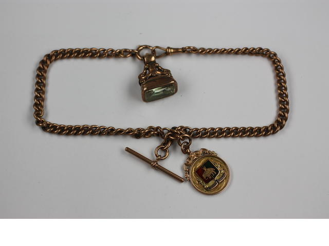 A late Victorian 9ct rose gold double graduated curb link watch chain, 'T' bar, bolt ring and swivel clasp, hung with a fob seal with foiled back stone and a 9ct gold and enamel medallion fob, 80g approximately gross.