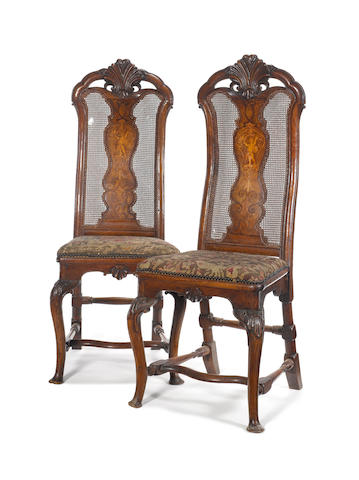 A pair of William and Mary carved walnut and marquetry side chairs