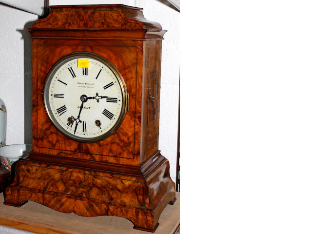 A Victorian walnut cased mantel clock,