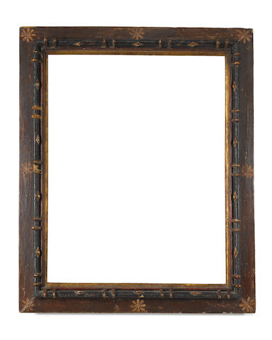 A Spanish 17th Century carved, polychromed and parcel gilt frame