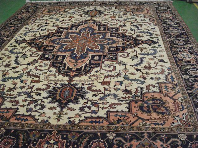 A Heriz design carpet 390cm x 307cm