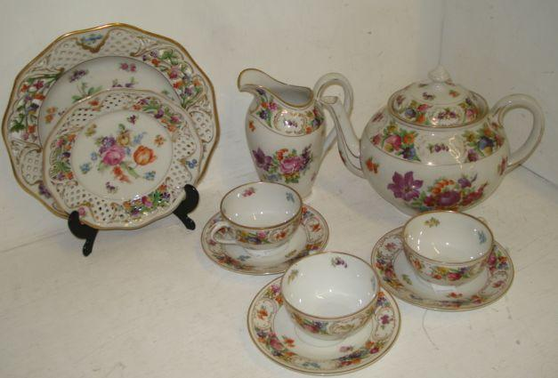 Eleven 20th Century Dresden ribbon plates, together with a Dresden Meissen style part tea service.