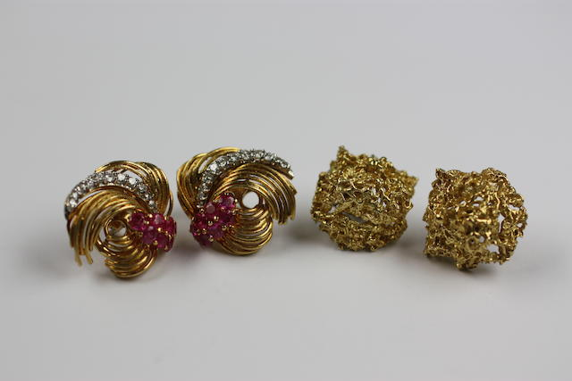 A pair of ruby and diamond whorl earclips, by Kutchinsky