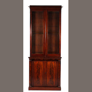 An early Victorian mahogany and glazed bookcase cabinet