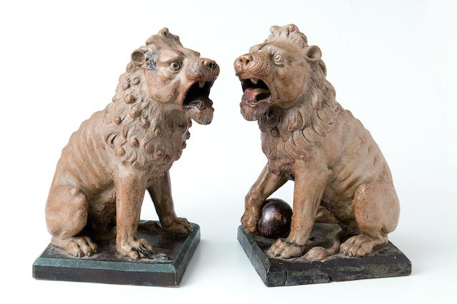 The Martin Brothers A Rare and Impressive Pair of Stoneware Lions, 1896-7