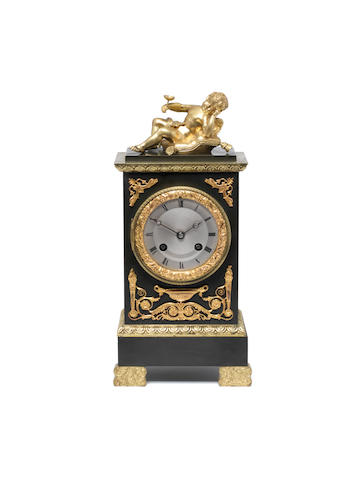A late 19th century French gilt and patinated bronze mantel clock. Marti