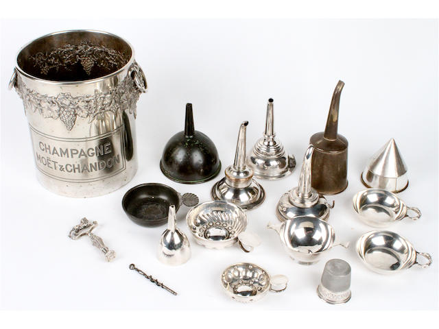 A group of silver wine related items