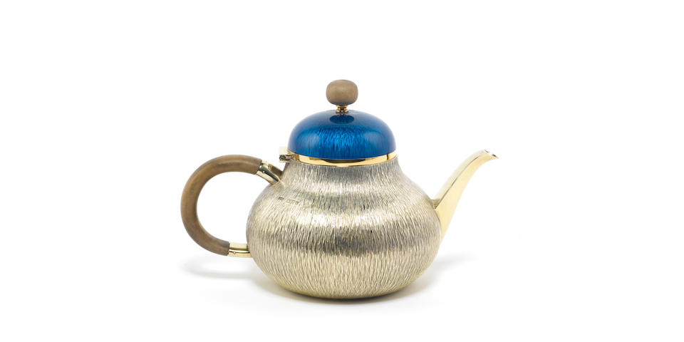 GERALD BENNEY: A silver-gilt and enamelled teapot