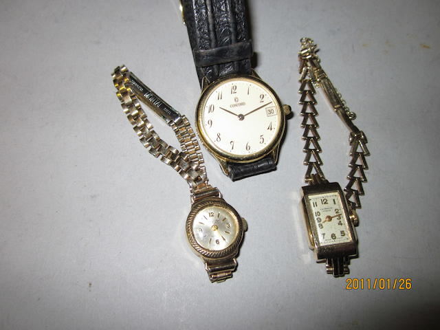 Concord: A gent's 18 carat gold strap watch,  (3)