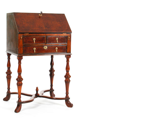 A small William & Mary-style burr walnut-veneered and line-inlaid bureau on stand