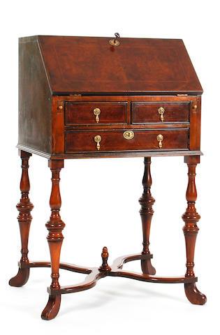A small William & Mary-style burr walnut-veneered and line-inlaid bureau on stand