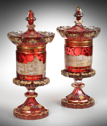 A fine pair of Bohemian enamelled Bohemian ruby-cased goblets and covers gilt with views of Hamburg, circa 1835-40